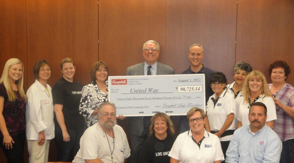 Image of Campbell's Soup Presents Check to United Way for $98,725