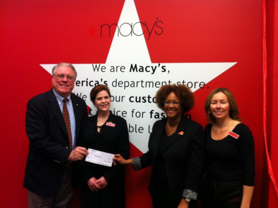 United Way CEO Steve Heath, Michelle Champoux of Macy's, V.P. of External Affairs for Macy's Carol Jackson and Danielle Manning of Macy's.