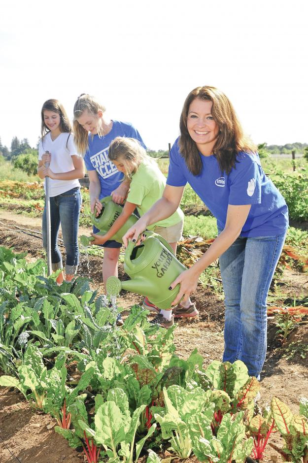 Intel Vice President Tammy Cyphert and her daughters take advantage of family time through volunteer activities they enjoy together.