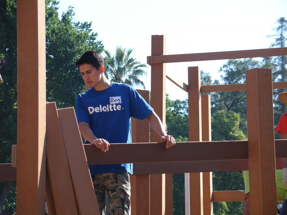 Deloitte IMPACT Day Volunteers help out at the McKinley Park Rebuild.