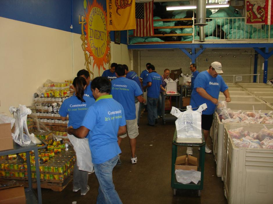 Deloitte IMPACT Day Volunteers help out in the food and clothing programs at Sacramento Food Bank & Family Services.