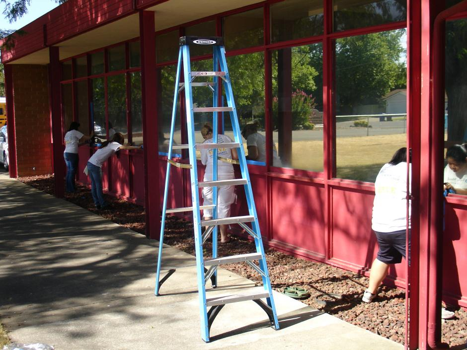 Some volunteers in both shifts worked on painting the entire exterior of the building.