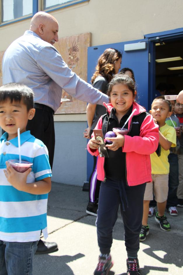 Students leaving the assembly with fruit smoothies and other goodies.