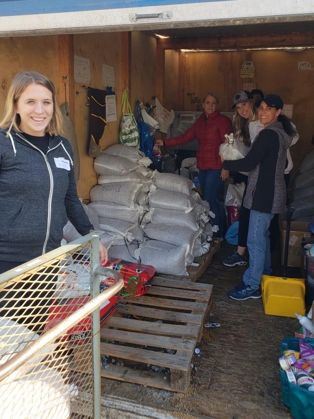 Eli Lily Company at Front Street Shelter organizing pet food pantry