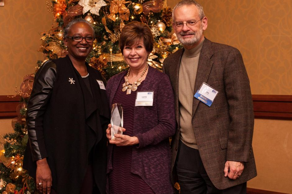 Women in Philanthropy Member of the Year, Lorrie Wilson (center). Pictured with Stephanie M. Bray and Jim Shetler.
