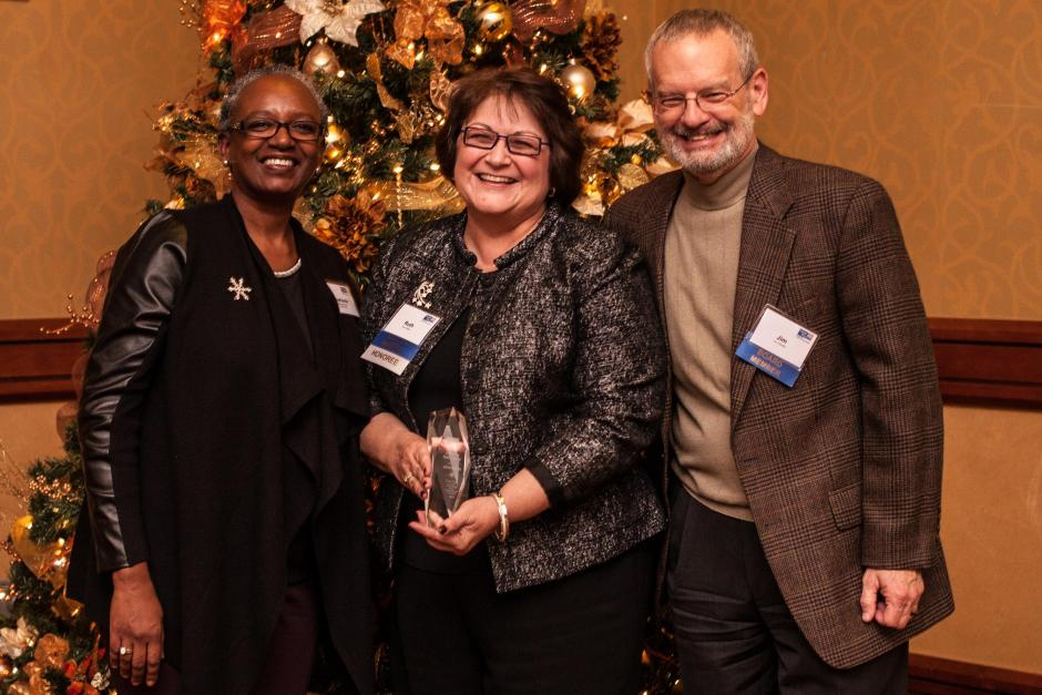Women in Philanthropy Member of the Year, Ruth Miller (center). Pictured with Stephanie M. Bray and Jim Shetler.