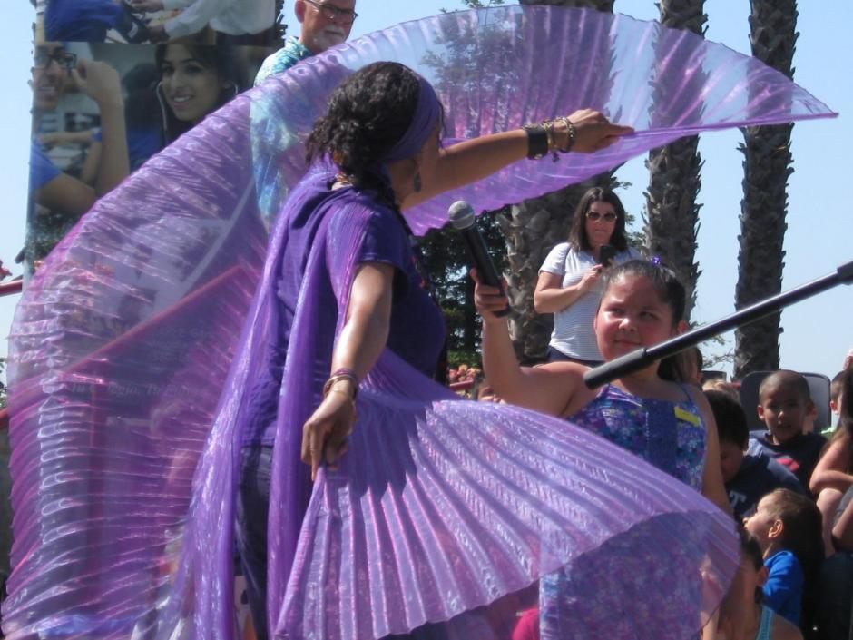 "Outdoor photo of a woman with purple chiffon ""wings"""