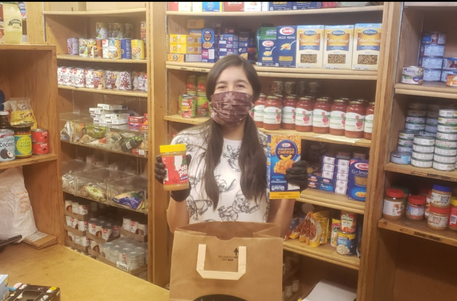 Young woman with a mask at a food pantry
